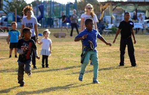 Children play dodgeball during the Freret Get-Together at Evans Park in December 2014. The event was hosted by the Evans Park Booster Club, with activities organized by Eric and Claudean Capers of Anytime Fitness. (Photo by Liz Jurey, courtesy of Freret Neighborhood Center)