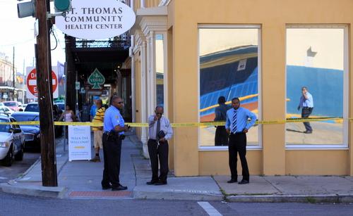 Three New Orleans police officers examine the crosswalk along Magazine Street where gunfire broke out on Wednesday morning. (Robert Morris, UptownMessenger.com)