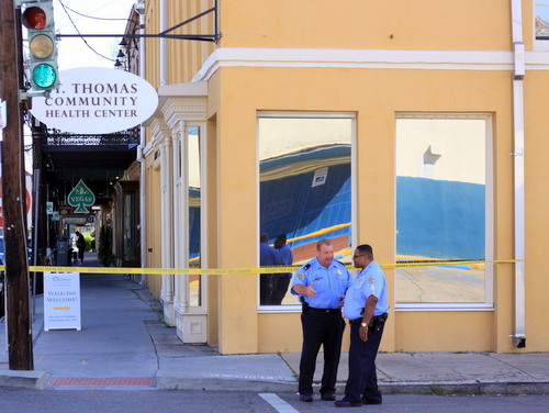 A NOPD lieutenant and sergeant confer at the corner of St. Andrew and Magazine, following a shooting in April 2015. (Robert Morris, UptownMessenger.com)