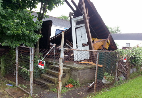 The ruins of a house at Annunciation and Upperline that collapsed during Monday morning's heavy storm.