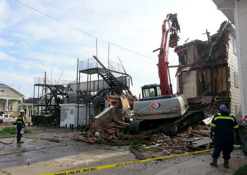 Construction equipment chews through the old structure on the Amelia Street side on April 20, 2015. (Robert Morris, UptownMessenger.com)