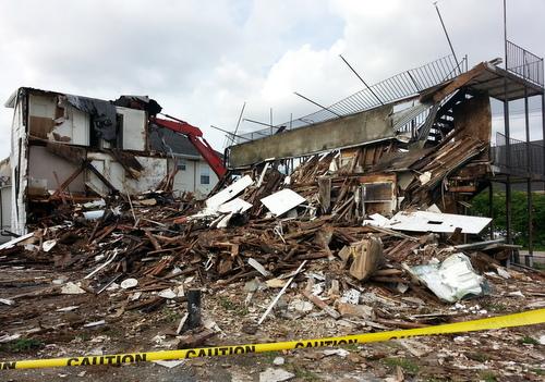 The apartment complex at 1900 Amelia Street, midway through its demolition. (Robert Morris, UptownMessenger.com)
