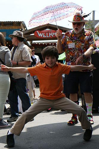 A young fan dances to Cha Wah. (Zach Brien, UptownMessenger.com)