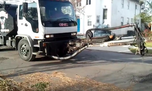 """The pothole killer working on State Street Drive in Marlyville, captured on video by YouTube user """"VideoNOLA."""" (image used with permission)"""