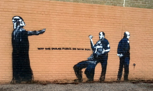 A Politically Themed Stencil On The Side Of The Priestley Gym, By A Street