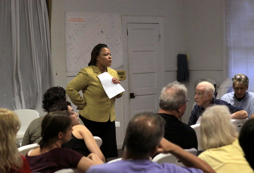 City Councilwoman LaToya Cantrell and property owner Ruppert Kohlmeier (seated, front row) listen to a question from the audience at the Irish Channel Neighborhood Association meeting Thursday. (Robert Morris, UptownMessenger.com)