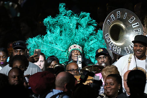 Rebirth Brass Band and Big Chief Monk Boudreaux lead a second line out at the end of the Katrina 10 commemoration at the Smoothie King Center on Saturday. (Zach Brien, UptownMessenger.com)