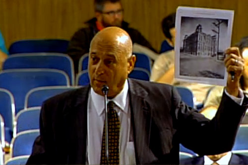 Attorney Rick Richter holds up a picture of the former McDonogh No. 8 building that was on the vacant land now at 3139 Constance Street, arguing that it represents the large-scale development that should be allowed there. (photo via nola.gov)