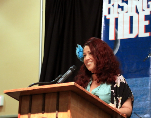 Deb Cotton accepts Rising Tide's annual Ashley Morris award. (Robert Morris, UptownMessenger.com)