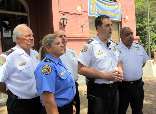 NOPD Second District Commander Paul Noel, center, discusses armed robberies at a September 2015 news conference surrounded by (from left) Deputy Chief Bob Bardy, Second District Lt. Jennifer Dupree, Sixth District Commander Ronnie Stevens and Chief Michael Harrison. (Robert Morris, UptownMessenger.com)