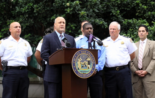Flanked by NOPD officials, Mayor Mitch Landrieu speaks at a news conference Monday afternoon. (Robert Morris, UptownMessenger.com)