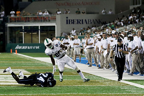 Tulane running back Dontrell Hilliard shoves off Maine cornerback Sinmisola Demuren on a run into the red zone. (Zach Brien, UptownMessenger.com)