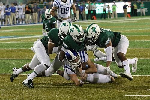 Linebacker Zachery Harris, linebacker Nico Marley and defensive back Jarrod Franklin bring down Duke quarterback Thomas Skirk on a run towards the end zone. (Zach Brien, UptownMessenger.com)
