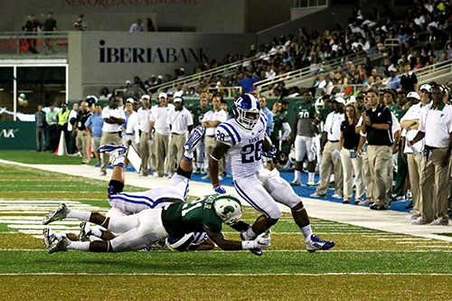 Duke running Shaun Wilson back breaks a tackle from cornerback Donnie Lewis Jr. Broken tackles were a big issue for Tulane's defense. (Zach Brien, UptownMessenger.com)