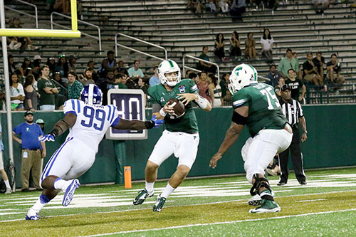 Tulane quarterback Tanner Lee steps up in the pocket to avoid a sack. (Zach Brien, UptownMessenger.com)