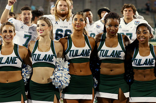 Tulane cheerleaders and players locked together arm-in-arm to sing the Alma Mater after Saturday's victory. (Zach Brien, UptownMessenger.com)