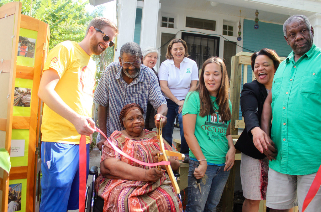Homeowners of 1823 Cadiz St. cut the ribbon to their new wheelchair ramp built by volunteers from Shell and Junior League of New Orleans.