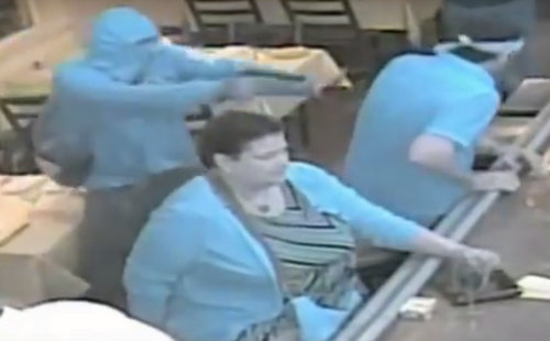 An image from the security videos at Patois. Detectives note that the infrared video changes the colors in the video, and that the turquoise clothing is actually shown as near-black in normal light. (image via NOPD)