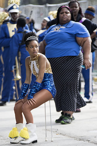 Baton girl from the Stella Wortley middle school marching band takes a rest during a lull in Krewe of King Arthur on Napoleon Avenue. King Arthur was one of four parades that rolled uptown on Sunday. (Zach Brien, UptownMessenger.com)