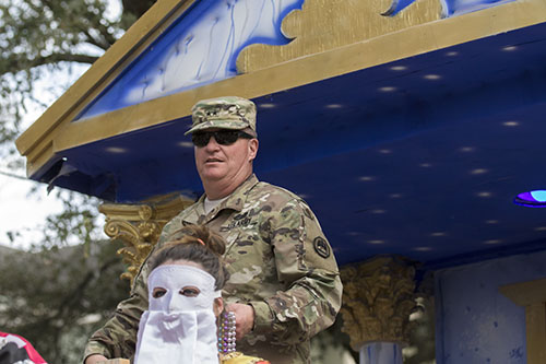 Major General Glenn H. Curtis, Krewe of Alla Grand Marshall, rides in the lead float in the parade. The Krewe of Alla was one of four parades to roll Sunday afternoon Uptown. (Zach Brien, UptownMessenger.com)