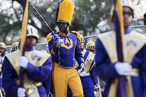 St. Augustine high school marching band gears up after a break in the parade during the Krewe of Alla. The Krewe of Alla was one of four parades to roll Sunday afternoon Uptown. (Zach Brien, UptownMessenger.com)