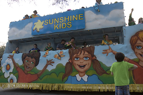 The Sunshine Kids float of the Krewe of Alla rolls down Napoleon Avenue. The Krewe of Alla was one of four parades to roll Sunday afternoon Uptown. (Zach Brien, UptownMessenger.com)