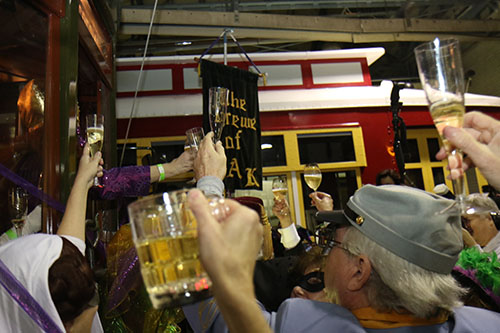 Masked revelers welcome in Carnival season 2016 in the Willow street streetcar barn before the Phunny Phorty Phellows embark on their annual ride. The event takes place on 12th night, 12 days after Christmas and is the first parade of Carnival season in New Orleans. (Zach Brien, UptownMessenger.com)