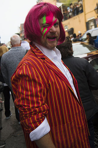 A man, dressed in his best David Bowie attire, posed for a photograph on a crowded St. Peter street. On Saturday, the Preservation Hall Jazz Band and members of Arcade Fire led a second line through the French Quarter in honor of musician David Bowie who died on January 10, 2016.