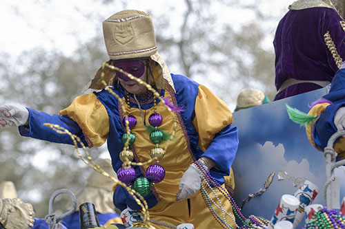 "A rider on the ""Connecticut , the _O_S_T_T__N State"" float  in the Krewe of Pontchartrain throws beads to an eager crowd on Napoleon avenue. The Krewe was one of five parades rolling Uptown on Saturday. (Zach Brien, UptownMessenger.com)"