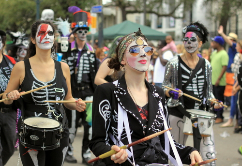 The Skinz N Bonez gang marches as the Mystic Krewe of Femme Fatale rolls on St. Charles Avenue. (Robert Morris, UptownMessenger.com)