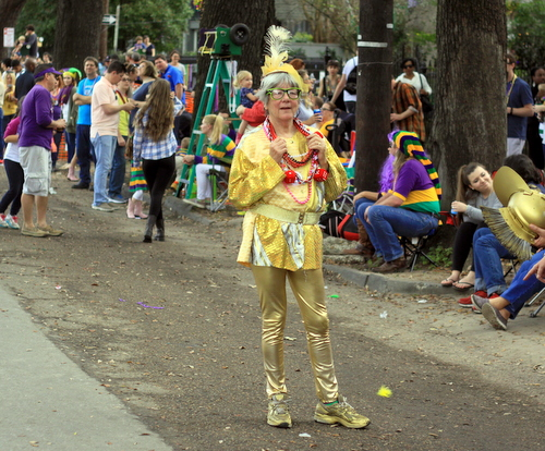 A costume reveler waits during a gap in the parade as the Mystic Krewe of Femme Fatale rolls on St. Charles Avenue. (Robert Morris, UptownMessenger.com)