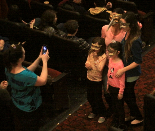 "A group of fans pose for a photo in masks as they wait for ""Labyrinth"" to begin. (Robert Morris, UptownMessenger.com)"