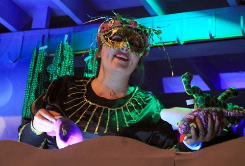 A rider in the Krewe of Cleopatra smiles as she tosses beads on Napoleon Avenue. (Robert Morris, UptownMessenger.com)