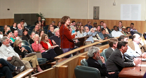 A resident asks the City Council for a compromise location for the proposed Carrollton Boosters sports complex as members of the Audubon Commission and Carrollton Boosters listen. (Robert Morris, UptownMessenger.com)