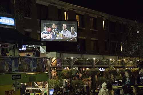 "Superior Grill, near the corner of St. Charles avenue and Amelia street, projected the Super Bowl onto a screen so people at Bacchus would not miss the game. Bacchus 2016 rolled with the theme ""Flights of Delight."" (Zach Brien, UptownMessenger.com)"