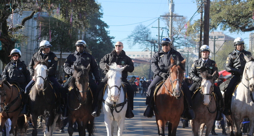 Mayor Mitch Landrieu, NOPD Superintendent Michael Harrison and other police officers ride on horseback in front of the Krewe of Zulu parade. (Robert Morris, UptownMessenger.com)