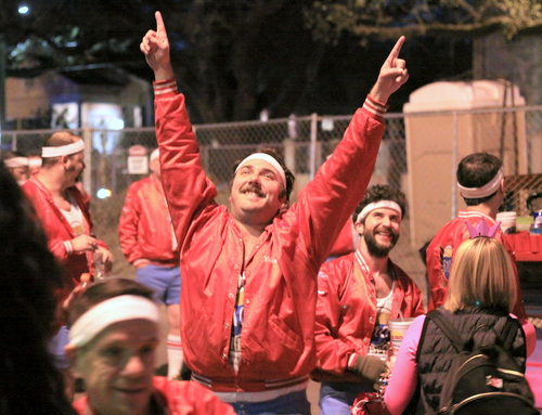 A member of the 610 Stompers signals to the audience as the Krewe of Hermes rolls on Napoleon Avenue. (Robert Morris, UptownMessenger.com)