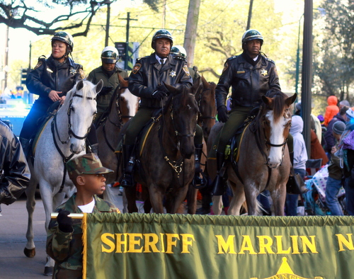 Sheriff Marlin Gusman and City Councilwoman LaToya Cantrell ride on horseback in the Zulu parade. (Robert Morris, UptownMessenger.com)