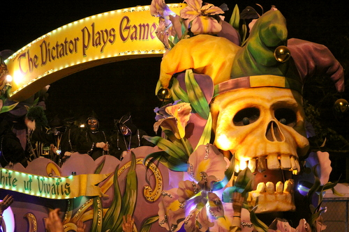 The title float in Le Krewe d'Etat rolls on Napoleon Avenue. (Robert Morris, UptownMessenger.com)