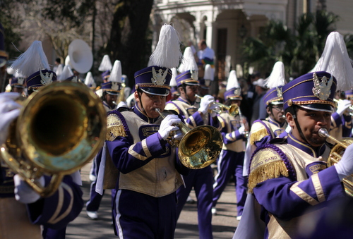 The Warren Easton marching band performs as the Krewe of Rex rolls on St. Charles Avenue. (Robert Morris, UptownMessenger.com)