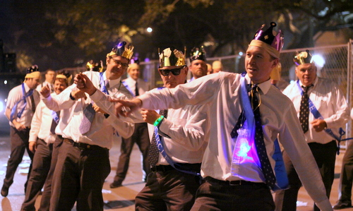 Monument Men dance as Le Krewe d'Etat rolls on Napoleon Avenue. (Robert Morris, UptownMessenger.com)