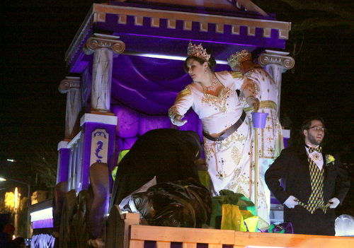 The queen tosses throws as the Krewe of Morpheus rolls on Magazine Street. (Robert Morris, UptownMessenger.com)