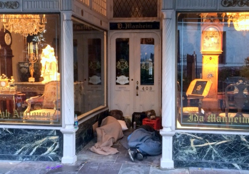 People sleeping in the doorway of a Royal Street business this past weekend. (photo by Danae Columbus for UptownMessenger.com)