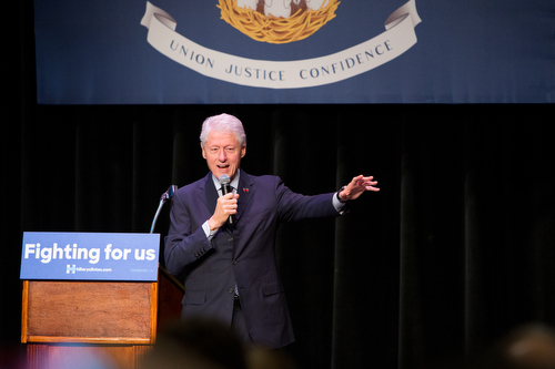 Former President Bill Clinton addresses the crowd at Ashe Power House in Central City on Friday morning. (Sabree Hill, UptownMessenger.com)