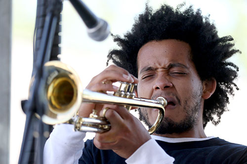Xavier Molina plays his trumpet with the Dominic Minix Quartet on the Loyola University stage at the 2016 Freret Street Festival. The event featured 18 artists on three stages, 35 food vendors and craft vendors ranging from Freret and Soniat to Napoleon Avenue. (Zach Brien, UptownMessenger.com)