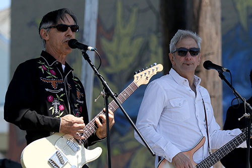 Rick Olivier, left, and Rob Savoy, right, lead the Creole String Beans on the Alder Hotel stage at the 2016 Freret Street Festival. The event featured 18 artists on three stages, 35 food vendors and craft vendors ranging from Freret and Soniat to Napoleon Avenue. (Zach Brien, UptownMessenger.com)
