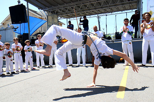 Capoeira students from NOLA Capoeira display their skills in front of the Home Bank stage at the 2016 Freret Street Festival. The event featured 18 artists on three stages, 35 food vendors and craft vendors ranging from Freret and Soniat to Napoleon Avenue. (Zach Brien, UptownMessenger.com)