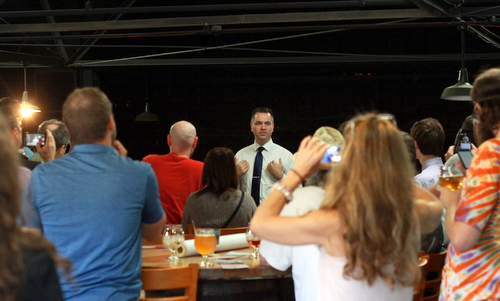 Libertarian Presidential candidate Austin Peterson (center) speaks at an event at NOLA Brewing on Tuesday, May 23. (Robert Morris, UptownMessenger.com)