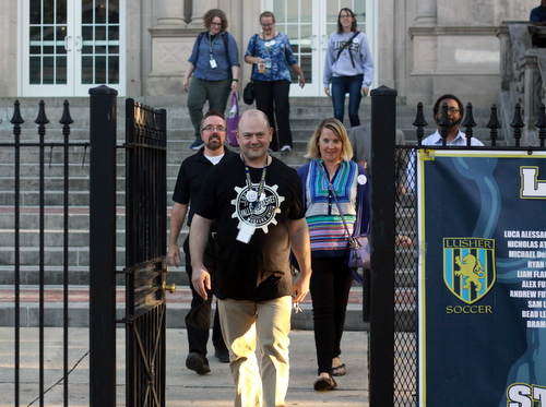 Members of the United Teachers of Lusher exit the building following Tuesday's vote on the union issue. (Robert Morris, UptownMessenger.com)
