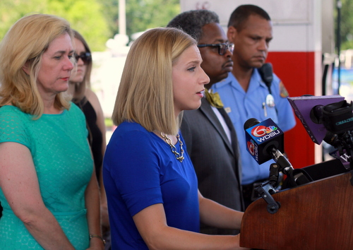 Elizabeth Fried, fiancee of Thomas Rolfes, speaks to reporters at a news conference hosted by CrimeStoppers on the one-month anniversary of Rolfes' death. (Robert Morris, UptownMessenger.com)